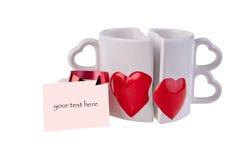 Le tazze da caffè nella forma di sentono Immagini Stock Libere da Diritti