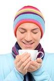 le tea för koppholdingman royaltyfria foton