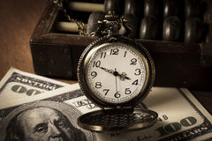 Le temps, c'est de l'argent, couleur de vintage Photographie stock libre de droits