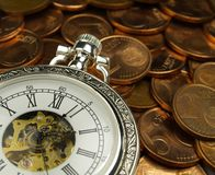 Le temps, c'est de l'argent cuivre Photographie stock libre de droits