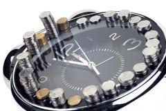 Le temps, c'est de l'argent et richesse images stock