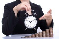 Le temps, c'est de l'argent ou temps travaille pour vous le concept Photo libre de droits
