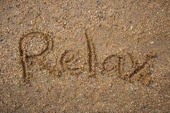 Le texte détendent sur le sand1 photo stock