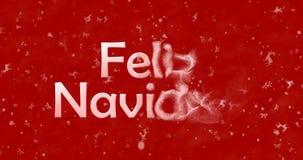 Le texte de Joyeux Noël dans l'Espagnol Feliz Navidad tourne pour épousseter le franc Images stock