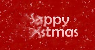 Le texte de Joyeux Noël se tourne vers la poussière de la gauche sur le fond rouge Photographie stock libre de droits