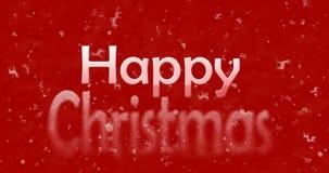 Le texte de Noël heureux se tourne vers la poussière du fond sur le fond rouge Photographie stock