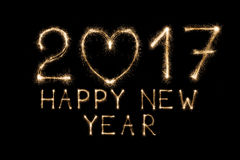 Le texte de nouvelle année, cierge magique numérote sur le fond noir Photo stock