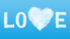 Le texte et le coeur opacifient dans le ciel bleu Images stock