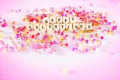 Le texte heureux de jour de valentines perle le concept Photographie stock
