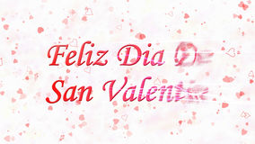 Le texte heureux de Saint-Valentin dans l'Espagnol Feliz Dia De San Valentin se tourne vers la poussière de la droite sur le fond Photographie stock