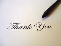 le texte remercient écrit vous Photographie stock