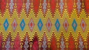 Le textile en soie thaïlandais traditionnel coloré Handcraft la texture photographie stock