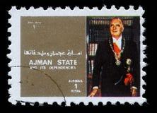 Le timbre imprimé par Ajman montre le Roi Boudewijn de la Belgique Photo stock