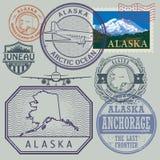 Le timbre a placé avec le nom et la carte de l'Alaska Image stock