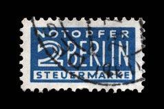 Le timbre postal d'impôts a imprimé en Allemagne en faveur de Berlin-Ouest photographie stock libre de droits