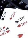 Le tisonnier quatre de casino d'Internet des as aimables carde des coeurs de combinaison Images libres de droits