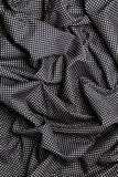 Le tissu de coton noir avec les points blancs conçoivent la texture Bandes de recouvrement Fond Photo libre de droits