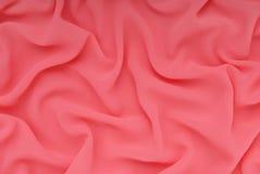 Le tissu a le fuchsia de couleur, milieux texturisés photo stock