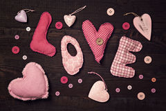 Le tissu marque avec des lettres l'amour illustration libre de droits