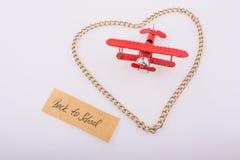 Le titre de nouveau à l'école dans le coeur et l'avion Photo libre de droits