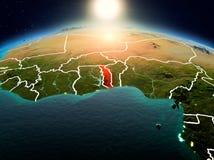 Le Togo dans le lever de soleil de l'orbite Photographie stock