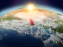 Le Togo de l'espace dans le lever de soleil Photo libre de droits