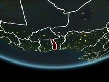Le Togo sur terre de l'espace la nuit Photo libre de droits