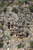 Le tombe del re hanno intagliato nelle rocce in myra antalya Fotografia Stock