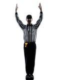 Le touchdown d'arbitre de football américain fait des gestes des silhouettes Photo stock