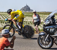 Le Tour de France Action. Le Pont Landais,France-July 10, 2013: The Yellow Jersey ( Chris Froome, Great Britain) pass through a group of excited spectators in Royalty Free Stock Photo