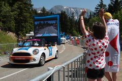 Le tour de France in Chamrousse. CHAMROUSSE, FRANCE, JULY 18, 2014 : Publicity caravan of the Tour de France. A convoy of vehicles with advertising character Stock Photo