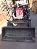 le tracteur de 🚜 peut construit dans le JCB image libre de droits