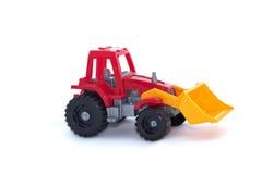 Le tracteur de jouet sur un fond blanc Image stock