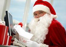 Le travail de Santa images stock