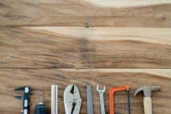 Le travail usine le cadre sur le bois photo stock