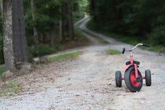 Le tricycle oublié photo libre de droits
