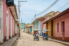 Le Trinidad circulant sur un tricycle Photographie stock