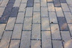 Le trottoir couvre de tuiles la photo horizontale de fond photo stock