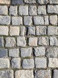 Le trottoir en pierre des blocs images stock