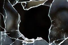 Le trou en verre fissure des débris image stock