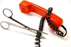 Le tube et les ciseaux de téléphone. Photographie stock