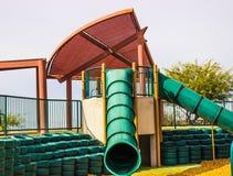 Le tube multiple glisse au parc d'enfants Photo stock