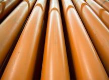 Le tuyau orange de PVC pour faire l'hygiène externe images stock