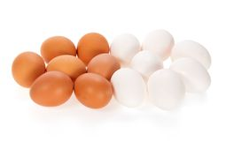 Le uova bianche e marroni Fotografia Stock