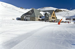 Le Vallon restoration area at Saint Lary Soulan ski resort. Textured snow surface od the ski slope is at foreground Stock Photography