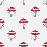 Le vecteur sans couture de pluie de modèle de parapluie a isolé le rouge de fond de papier peint Photo stock