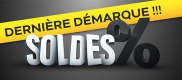 Le vendite durano la riduzione in francese: Démarque del dernière di Soldes Immagini Stock