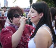 Le ventilateur polonais effectue la peinture de visage Photographie stock