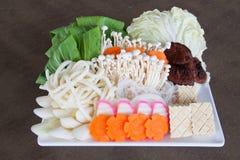 Le verdure giapponesi in piatto bianco Immagine Stock