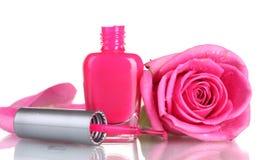 Le vernis à ongles rose avec a monté photos stock